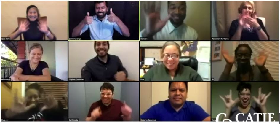 Screen shot of Zoom meeting with 12 deaf people of color waving at the screen in farewell